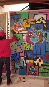 Street artist A. McIlwaine at work
