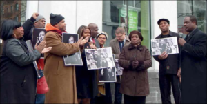 TD Bank accepts demands and closes branches on Martin Luther King holiday. Celebrating the victory are: Dolly Finney, James Robinson Geoffrey Davis, Tai Johnson, James R. Ray, III, Canon Diane M. Porter, Attorney Michael T Mullen, Assemblywoman Annette M. Robinson, Bruce Green, President Bed-Stuy Anti-Violence Coalition, Rev. W. Taharka Robinson. Stained glass ceiling broken. Dr. Sharon Codner-Walker presents Rev. Holman, newly-named first woman minister of Bethany Baptist Church. (photo:  Mark Stewart)