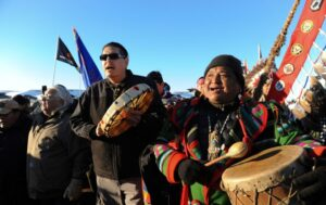 Indigenous water protectors and their allies celebrate that the Army Corps of Engineers has denied an easement for the Dakota Access Pipeline on December 4, 2016. (Reuters / Lucas Jackson)