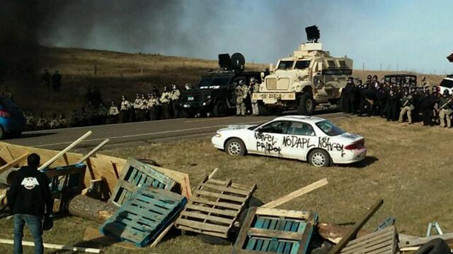 Developing: 100+ Militarized Police Raiding #NoDAPL Resistance Camp Blocking Pipeline's Path