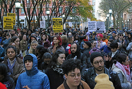 "Hundreds descended on Metrotech Plaza demanding an end to overly aggressive police conduct. ""About six of them or eight of them were on top of him. One put his knee in his neck. He kept saying, 'I can't breathe, I can't breathe,' and they would not let up. They handcuffed him. Slammed him into a sign."" Photo: Lem Peterkin"