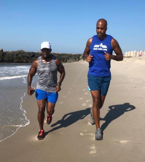 Patrick Burnett, left, with Marlon on training run at the beach.